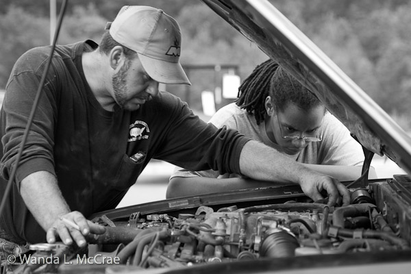 T and her pal R, working on his truck.
