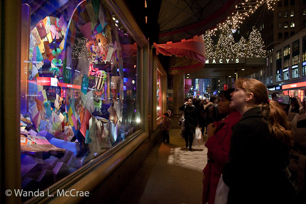 People watch the Macy's holiday display in awe