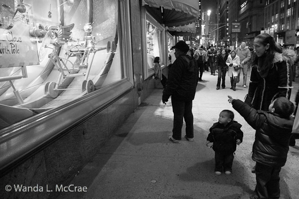 A child exclaims over what he sees in the Macy's window